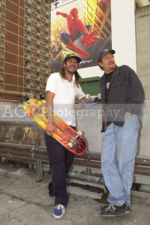 Skateboard pioneers TONY ALVA, left, and STACY PERALTA, stand on the roof of a San Francisco Hotel during  a press juncket for their award winning documentary film DOGTOWN AND Z-BOYS that opens May 3.  The Movie Spiderman also opens May 3. Alva and Peralta were instrumental in bringing skateboarding to the mainstream in the 1970's in Southern California. (Photo by Alan Greth)