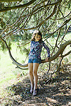 Berkeley CA Girl, seven, enjoying playing in tree branches at park  MR