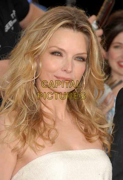 "MICHELLE PFEIFFER .attends The Newline Cinemas' L.A. Premiere of ""Hairspray"" held at The Mann Village Theatre in Westwood, California, USA, July 10 2007.                                                              portrait headshot gold hoop earrings.CAP/DVS.©Debbie VanStory/Capital Pictures"