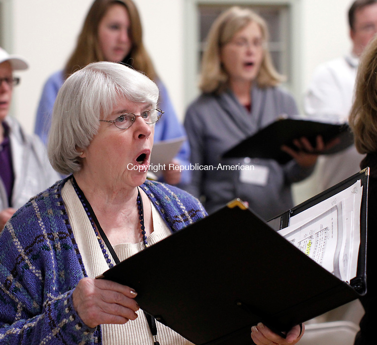 Southbury, CT- 15, November 2010-111510CM13 Nancy Liedlich, an alto singer, rehearses with the Connecticut Choral Society Monday night at the South Britain Congregational Church. The 120-voice choir celebrates it's 30th anniversary with some special concerts.   Christopher Massa Republican-American