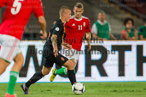 Netherlands' Jordy Clasie (C) and Hungary's Vladimir Koman (R) fight for the ball during a World Cup 2014 qualifying soccer match Hungary playing against Netherlands in Budapest, Hungary on September 11, 2012. ATTILA VOLGYI