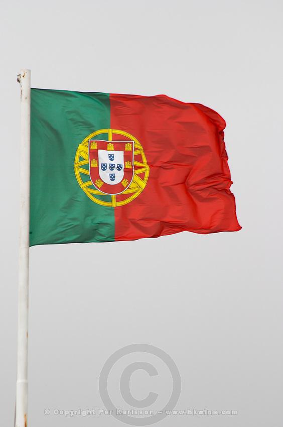 Portuguese flag fluttering on the Castelo de Sao Jorge fortress. Lisbon, Portugal