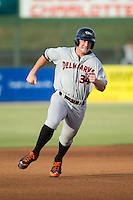 Conor Bierfeldt (34) of the Delmarva Shorebirds hustles towards third base against the Kannapolis Intimidators at CMC-NorthEast Stadium on July 2, 2014 in Kannapolis, North Carolina.  The Intimidators defeated the Shorebirds 6-4. (Brian Westerholt/Four Seam Images)