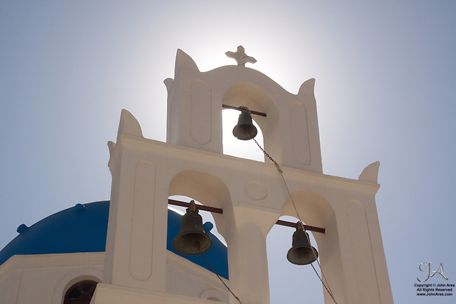 Backlit bell tower of a Greek Church