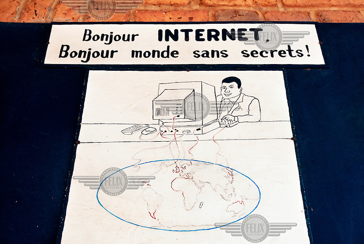"""A sign at a school in Nyanza reads: """"Hello Internet, Hello world without secrets.""""."""