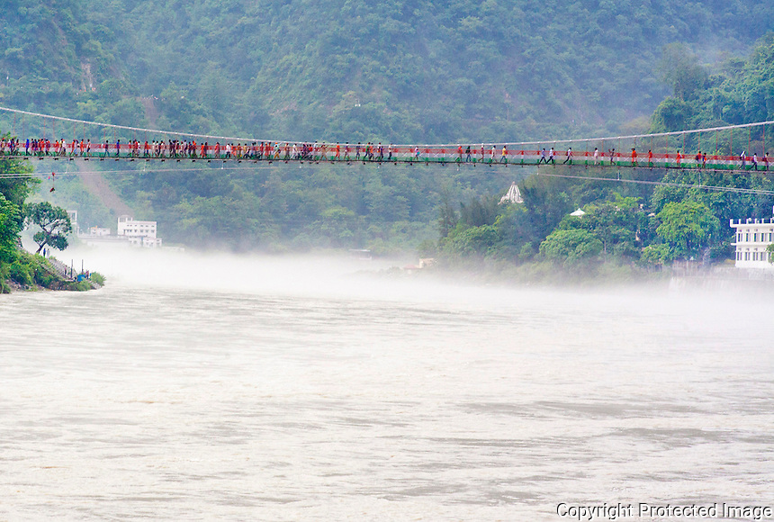28 July 2016 - Rishikesh , INDIA :<br /> Devotees cross over the Laxman Jhula bridge over the Ganges river at Rishikesh.<br /> <br /> (photo : Subhash Sharma)