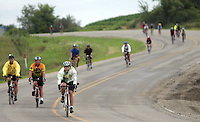 Riders descend a winding hill on county highway V18 three miles north of Chelsea on RAGBRAI XXXVI.