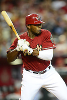 Apr. 22, 2012; Phoenix, AZ, USA; Arizona Diamondbacks batter Justin Upton reacts as he is hit in the hand by a pitch in the fifth inning against the Atlanta Braves at Chase Field. Mandatory Credit: Mark J. Rebilas-