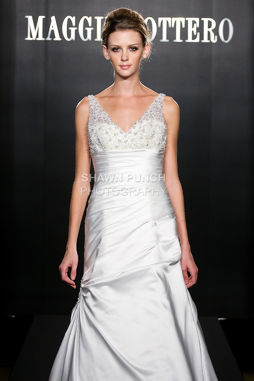 Model walks the runway in a Bliss Royale Couture wedding dress from the Maggie Sottero Bridal Spring 2012 collection, during  Couture: New York Bridal Fashion Week 2012