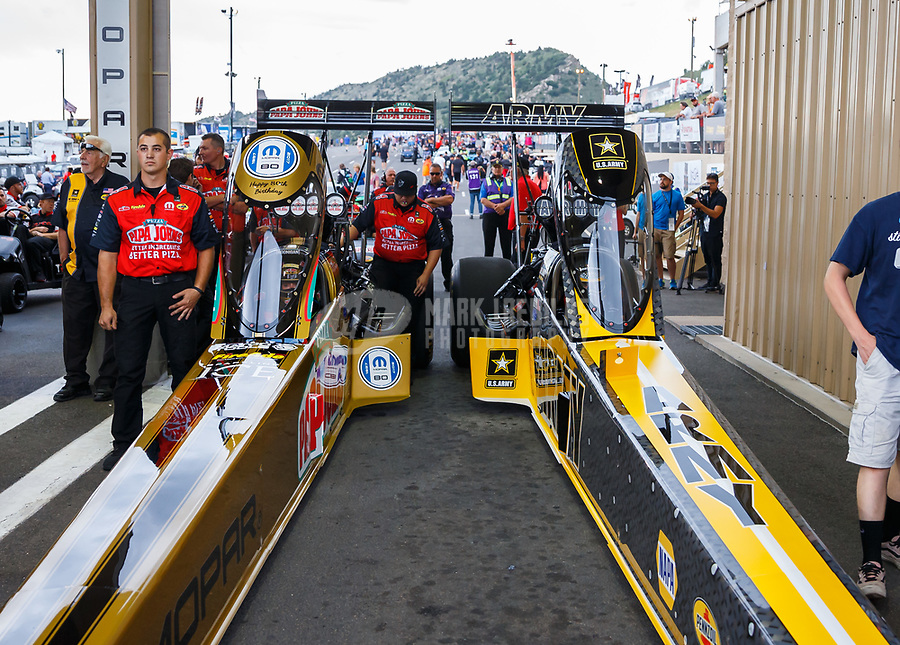 Jul 21, 2017; Morrison, CO, USA; NHRA top fuel driver Leah Pritchett (left) alongside teammate Tony Schumacher during qualifying for the Mile High Nationals at Bandimere Speedway. Mandatory Credit: Mark J. Rebilas-USA TODAY Sports
