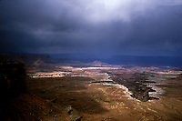 Rain storms move across the White Rim at Canyonlands National Park in southern Utah.