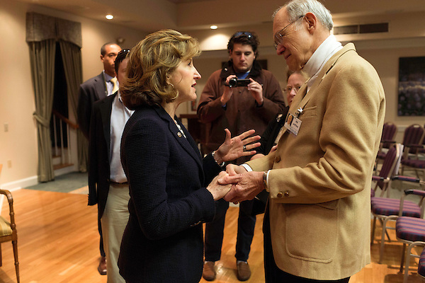 """April 16, 2014. Durham, North Carolina.<br />  Senator Kay Hagan, left, spoke with Bill Jeffries after an event to award a posthumous Bronze Star. Hagan has been largely absent from the campaign trail even as several Republican challengers have mounted campaigns to defeat her in this year's election.<br />  Kay Hagan (D),  US Senator from North Carolina, attended an event to honor the military service of Donald """"Buddy"""" Moore, Hagan awarded Moore's widow Wanda a posthumous Bronze Star, as well as several other medals, for his service in World War II."""