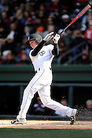 Right fielder Connor Bright (4) of the South Carolina Gamecocks bats in the Reedy River Rivalry game against the Clemson Tigers on Saturday, February 28, 2015, at Fluor Field at the West End in Greenville, South Carolina. South Carolina won, 4-1. (Tom Priddy/Four Seam Images)