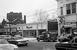 Pittsburgh PA - View of the Forbes Avenue business district near the bluff - 1962. Other stores on the block; Forbes Hardware Store, Klyne's Clothing Store, Oliver Flower Shop and Hanna Chapeaux