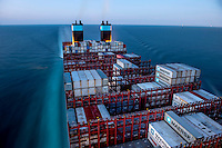The Mary Maersk, the largest container ship in the world, travelling at night in the North Sea.