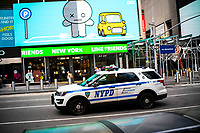 "NEW YORK, NEW YORK - SEPTEMBER 3: A NYPD car patrols at Times Square on September 3, 2020 in New York. U.S. President Trump has ordered to the federal government to begin the process to defund NYC and three other cities where protest ""lawless"" were allowed and police budgets were cut, rising violent crime. (Photo by Eduardo MunozAlvarez/VIEWpress via GettyImages)"