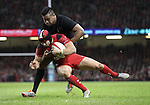 All Blacks wing Julian Savea tackles Wales full back Leigh Halfpenny.<br /> Dove men Series 2014<br /> Wales v New Zealand<br /> 22.11.14<br /> &copy;Steve Pope -SPORTINGWALES