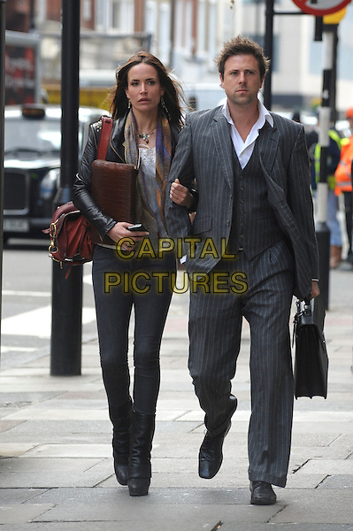 SOPHIE ANDERTON & FRIEND.Spotted walking through central .London, England, UK, May 7th 2010..full length  black leather jacket skinny jeans pinstriped suit grey gray brown bag  boots white top scarf .CAP/DYL.©Dylan/Capital Pictures.