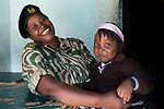 Park warden, Miriam Namushi, with her granddaughter, Kafue National Park, Zambia