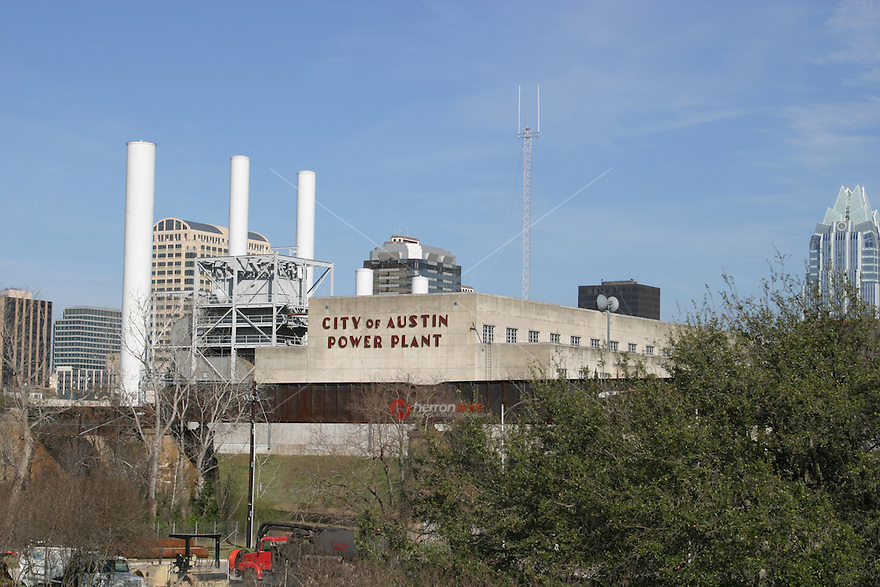 It's a beautify sunny day at city of austin power plant on town lake in austin, TX.