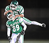 Luke Farrant #89 of Seaford, bottom, gets congratulated by Danny Roell #23 after catching a pass for a first down on a faked punt play in Nassau County varsity football Conference IV semifinals against Locust Valley at Hofstra University on Saturday, Nov. 12, 2016. Seaford won by a score of 28-14.