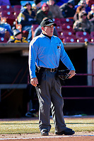Home plate umpire Randy Wilmes looks on between innings of a Midwest League game between the Wisconsin Timber Rattlers and the Beloit Snappers on April 7, 2018 at Fox Cities Stadium in Appleton, Wisconsin. Beloit defeated Wisconsin 10-1. (Brad Krause/Four Seam Images)