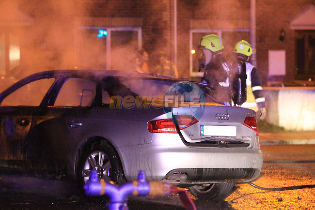 Drogheda fire service were called to a car fire which was used minutes earlier in a robbery from Tesco superstore. The car was abandoned and set on fire in the residential estate..Picture www.newsfile.ie