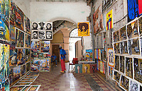 Havana Cuba man in gallery at medina in Old Havana selling paintings artwork   4