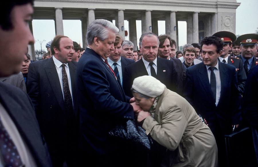 Gorky Park, Moscow, Russia, 09/05/1992..A woman breaks through a security cordon to kiss the hand of Russian President Boris Yeltsin as he visits the parke on Veteran's Day.