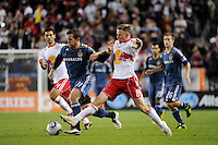 Chad Barrett (11) of the Los Angeles Galaxy and Jan Gunnar Solli (8) of the New York Red Bulls. The New York Red Bulls defeated the Los Angeles Galaxy 2-0 during a Major League Soccer (MLS) match at Red Bull Arena in Harrison, NJ, on October 4, 2011.