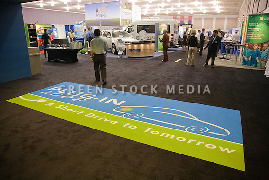 People at the opening day of the July 22-24 inaugural Plug-In 2008 Conference & Exposition: A Short Drive to Tomorrow in San Jose, CA. The event showcases the latest technological advances, market research and policy initiatives shaping the future of plug-in hybrid electric vehicles (PHEVs). San Jose, California, USA