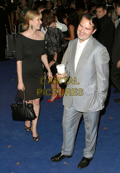 "KAROLINE COPPING & JIMMY CARR.""Miami Vice"" UK film premiere, Odeon Leicester Square, London UK..July 27th, 2006.Ref: AH.full length grey gray suit starbucks drink black dress purse bag.www.capitalpictures.com.sales@capitalpictures.com.©Adam Houghton/Capital Pictures."