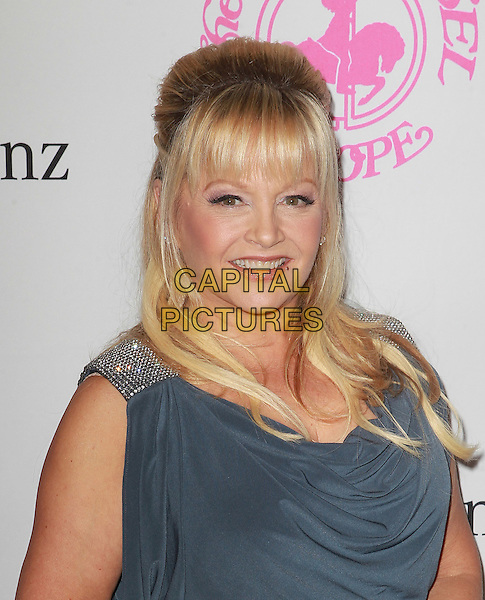 Charlene Tilton.26th Annual Carousel of Hope Gala held at the Beverly Hilton Hotel, Beverly Hills, California, USA..20th October 2012.headshot portrait blue  .CAP/ADM/KB.©Kevan Brooks/AdMedia/Capital Pictures.