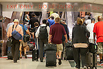 Passengers use an escalator to head to ground transportation and baggage claim at Hartsfield–Jackson Atlanta International Airport, in Atlanta, Georgia on August 28, 2013.
