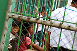 Children begging on the bridge linking Thailand and Myanmar (Burma) in Mae Sai.<br /> <br /> As well as reaching out to children on the streets, UNICEF operates programmes to prevent child trafficking and to help get victims safely back with their families.<br /> <br /> In May 2007, Qantas staff from the Change for Good programme visited UNICEF in northern Thailand to see how the money they have raised is helping children. This photo essay describes what they saw.