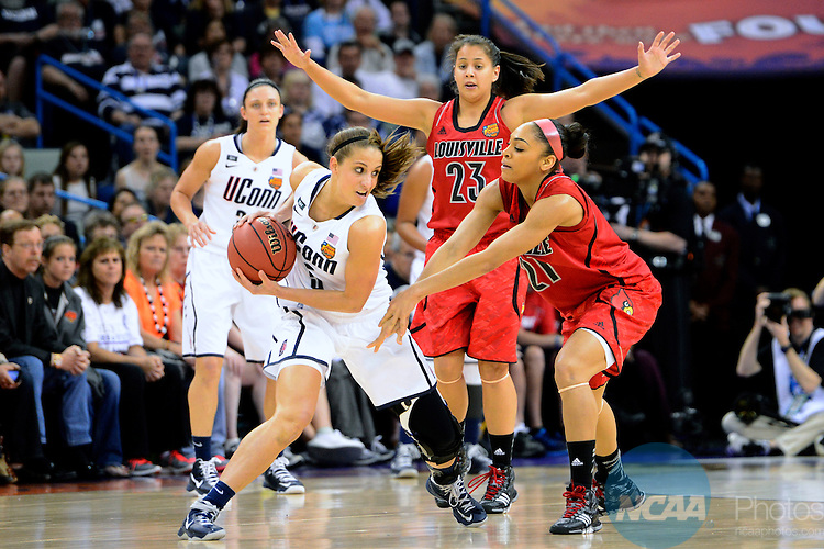 09 APR 2013:  Bria Smith (21) of the University of Louisville pressures Caroline Doty (5) of the University of Connecticut during the Division I Women's Basketball Championship in New Orleans, LA.  Connecticut defeated Louisville 93-60 to capture their eighth national championship.  Jamie Schwaberow/NCAA Photos