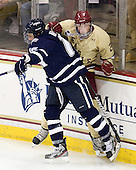 John Henrion (UNH - 16), Brian Dumoulin (BC - 2) - The Boston College Eagles defeated the visiting University of New Hampshire Wildcats 4-3 on Friday, January 27, 2012, in the first game of a back-to-back home and home at Kelley Rink/Conte Forum in Chestnut Hill, Massachusetts.