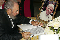 "Photo File/Havana, Cuba. April 4, 2005.- Former Cuban President Fidel Castro signed the ""Book of Condolences"" at the headquarters of the Catholic Nunciature in Havana for the death of Pope John Paul II. The Cuban Cardinal Jaime Ortega, who with Pope Francisco helped the restoration of relations between Cuba and the United States. Ortega will leave the leadership of the Catholic Church on the island, said Vatican. . Credit: Jorge Rey/MediaPunch"
