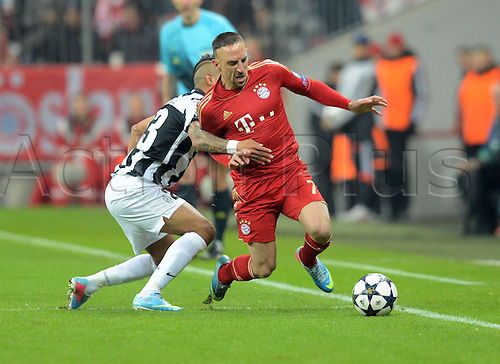 02.04.2013. Munich, Germany.  Champions League Quarter-finals Leg FC Bavaria Munich versus Juventus  in the Munich Alliance Arena.  Arturo Vidal Juventus versus Franck Ribery Munich