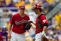 Stony Brook Seawolves pitcher Tyler Johnson #44 talks with catcher Pat Cantwell #3 on the mound during the NCAA Super Regional baseball game against LSU on June 9, 2012 at Alex Box Stadium in Baton Rouge, Louisiana. Stony Brook defeated LSU 3-1. (Andrew Woolley/Four Seam Images)