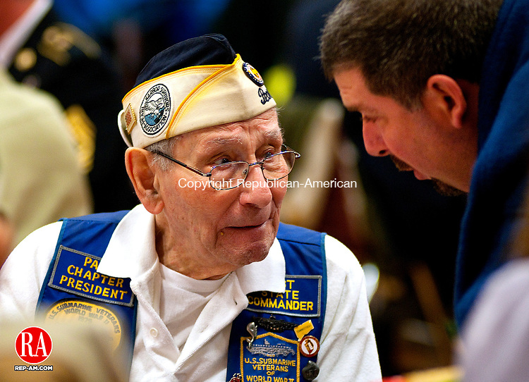 CHESHIRE,  CT, 07 NOVEMBER 2011-120711JS01-Anthony Richard of Prospect, right, talks with Pearl Harbor survivor William Lehr, 91, of Hamden during a special ceremony honoring WWII veterans Wednesday at Cheshire High School. Veterans from all other wars were also on hand for the event. Lehr was serving on the destroyer USS Monaghan during the attacks and witnessed the sinking of the USS Arizona. <br />  Jim Shannon Republican-American