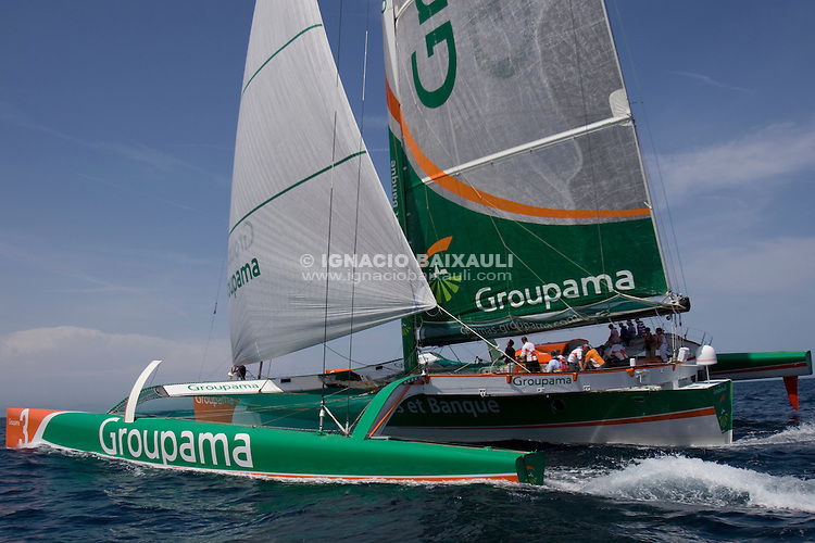 Groupama, the Frank Cammas trimaran is in Valencia invited by BMW Oracle