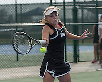 STAFF PHOTO ANTHONY REYES &bull; @NWATONYR<br /> Kendra Dinsmore, of Bentonville, returns a volley during a double match at the 7A-West Conference girls tennis tournament Wednesday, Oct. 8, 2014 at the Springdale Har-Ber tennis courts.