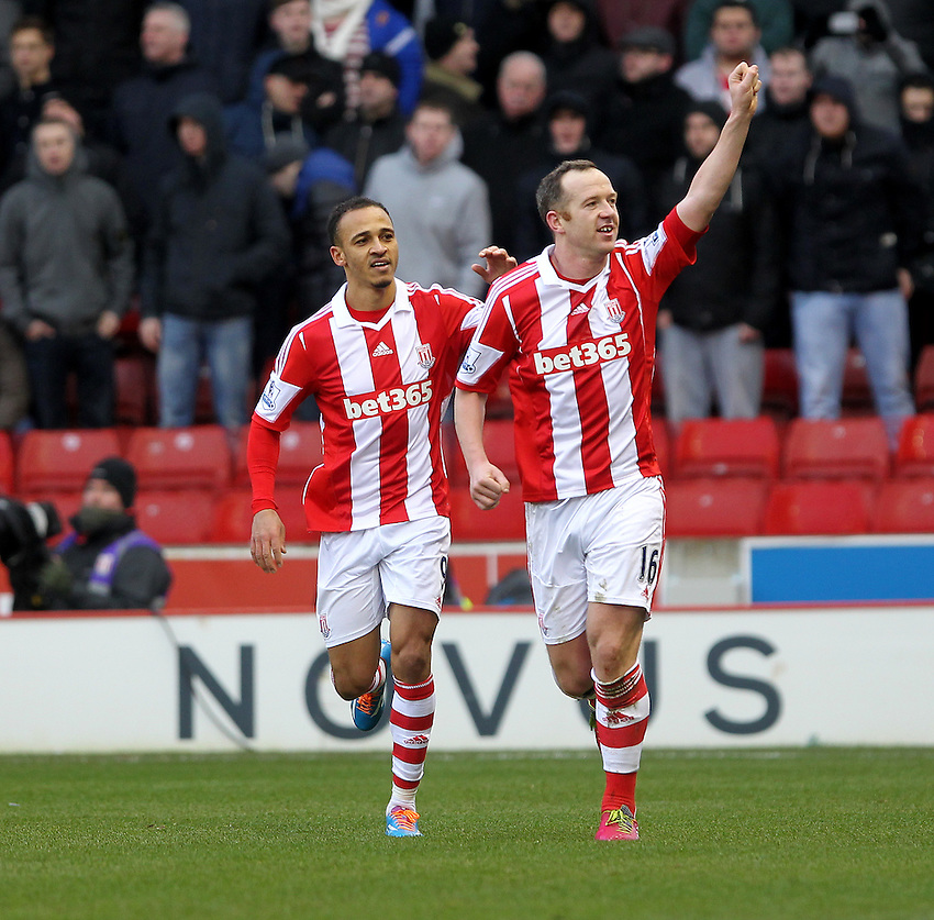 Stoke City's Charlie Adam celebrates scoring his sides first goal  with  Peter Odemwingie<br />