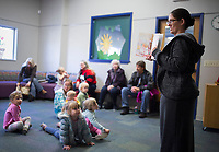 NWA Democrat-Gazette/CHARLIE KAIJO Dara Stein, assistant children's director, reads a story to children, Monday, December 2, 2019 during the Storytime Express early childhood development program at the Rogers Public Library in Rogers.<br /> <br /> Storytime Express is a traditional storytime for ages 3-5 years. Children read stories, sing songs, do movement rhymes and make a craft. Each week they focus on a different letter of the alphabet. Programs at the library will conclude during the week of Christmas and will resume again after the new year.