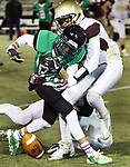 WATERBURY CT. 22 November 2017-112217SV09-#82 Alemar Blondet of Wilby High fumbles as #1Juan Salazar of Sacred Heart/Kaynor defends in the 1st quarter at Municipal Stadium in Waterbury Wednesday.<br /> Steven Valenti Republican-American