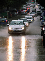 WEATHER PICTURE WALES<br /> Cars drive through a paddle in Walter Road during a sudden downpour in the city centre of Swansea, Wales, UK. Friday 15 September 2017
