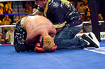 Uncasville, CT:  Realizing that he just won the fight, Paulie Malignaggi  falls on his knees at the end of his IBF Junior Welterweight Championship fight against Lovemore N'Dou at the Mohegan Sun Casino, June 16th, 2007. Malignaggi won the belt from N'Dou by unanimous decision.. Photo by Thierry Gourjon.