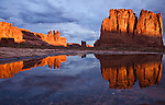 Courthouse Towers reflected in a pool at sunrise after a rain in Arches National Park, near Moab, Utah.