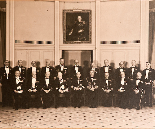Great Grandfather, Commodore Robert Lancelot Fortescue Hubbard,  Seated in the middle of the Front Row is the Master of Trinity House, then to his right is seated Winston Churchill and behind him , standing is Lord Louis Mountbatton uncle of the Duke of Edinburugh (Mountbatton was blown up by the I>R>A).  On the extreem Left of the Duke is Great Grandfather.  Behind the Duke is Atlee who was Labour Prime minister after the war which was a real slap in the face to Churchill!